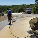 Fannin Employee with Paver in a Driveway
